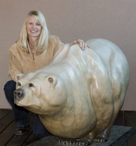 Kim Chavez with Bronze Bear Sculpture