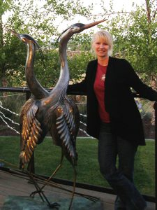 Kim Chavez with Herons Broze Sculpture